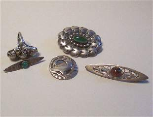 FIVE STERLING SILVER BROOCHES