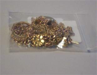 A GROUP OF YELLOW GOLD JEWELRY PIECES