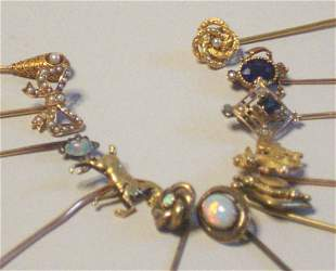 ELEVEN ASSORTED YELLOW GOLD STICK PINS