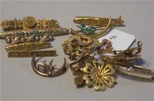SIXTEEN ANTIQUE GOLD PINS