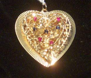 A 14K YELLOW GOLD HEART-SHAPED PENDANT