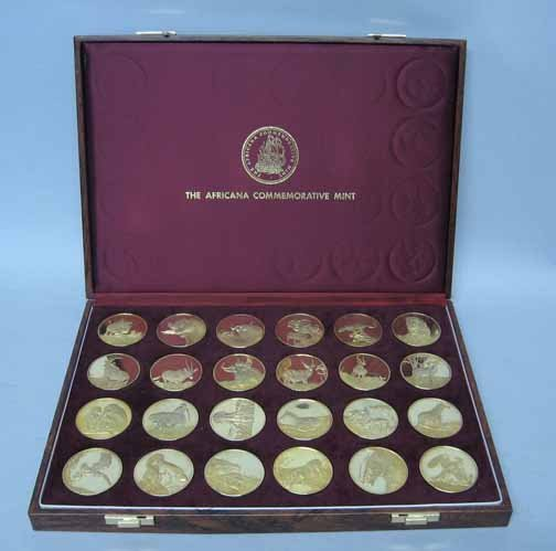 8: Twenty Four Gold Plated Commemorative Coins, , From