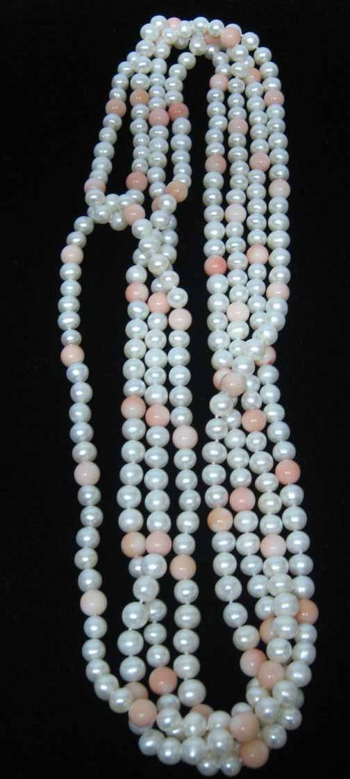 19: Lady's Pearl and Coral Bead Opera Length Necklace,
