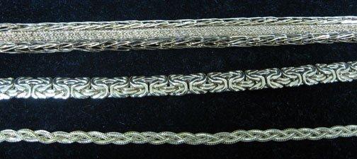 23: Flexible yellow gold bracelets, , Three flexible li