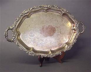 AN ENGLISH SILVER PLATED OVAL TEA TRAY