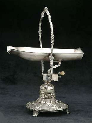 A FRENCH SILVER PLATED WINE CRADLE