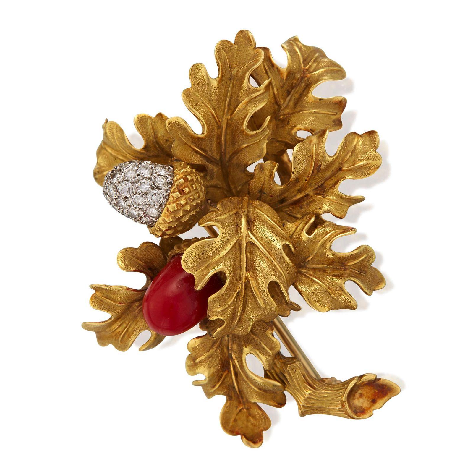 An eighteen karat gold, platinum, diamond, and coral