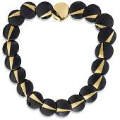 An onyx and eighteen karat gold necklace, Angela