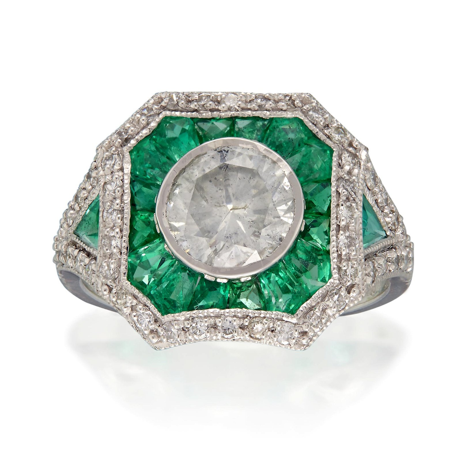 A diamond, emerald, and platinum ring,