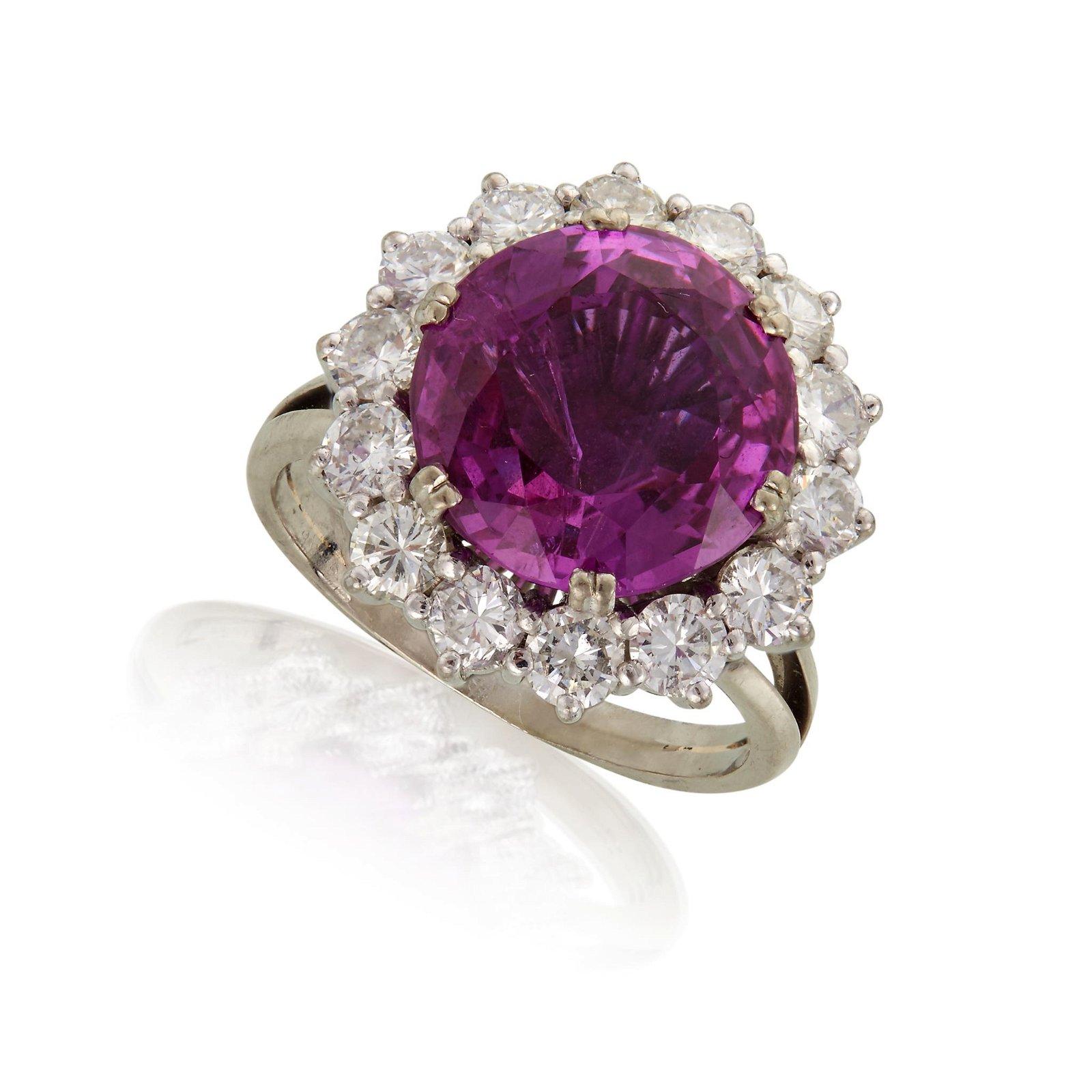 A platinum, pink sapphire, and diamond ring,
