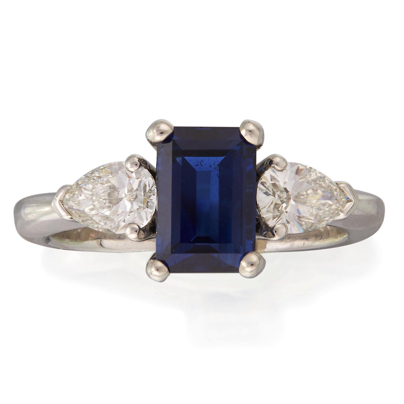 A sapphire, diamond, and platinum ring,