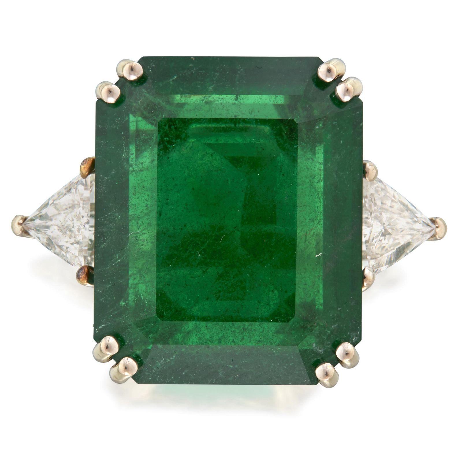 An emerald, diamond, and fourteen karat white gold
