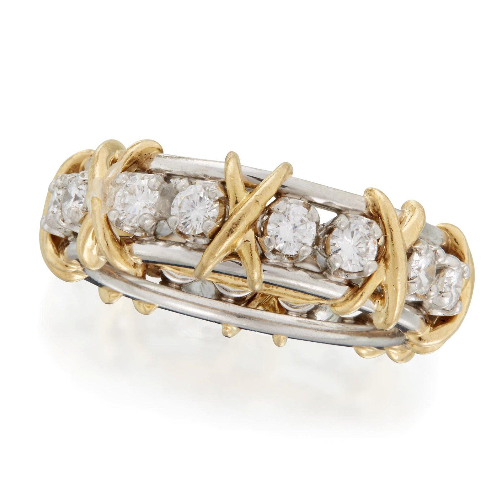 A diamond, eighteen karat gold, and platinum band,