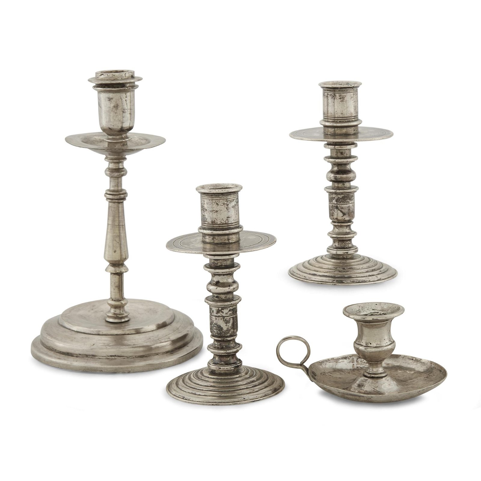 Group of four Spanish Colonial silver candlesticks,
