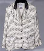 622: CHANEL BLACK AND WHITE TWEED JACKET In a cotton an