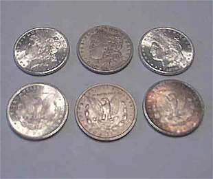 Four 1879-S U.S. silver dollars, , Together with