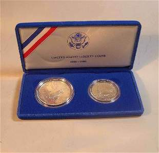 Four 1986 U.S. Liberty coin sets, , Boxed. (8 coi