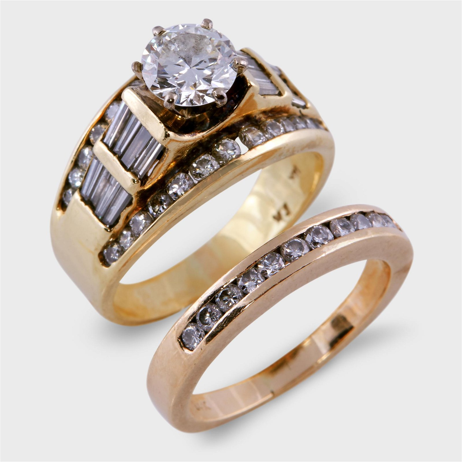 A diamond and fourteen karat gold bridal set,