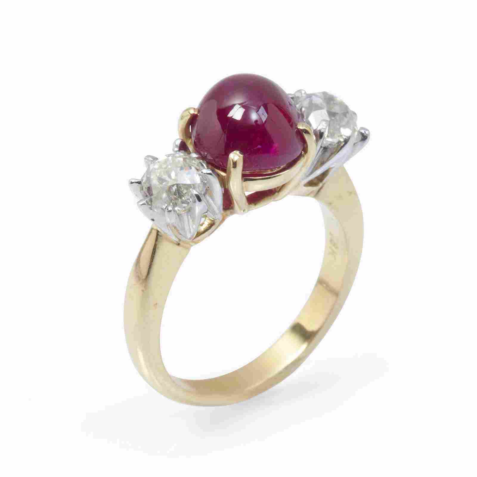 A Burma ruby, diamond, and eighteen karat gold ring,