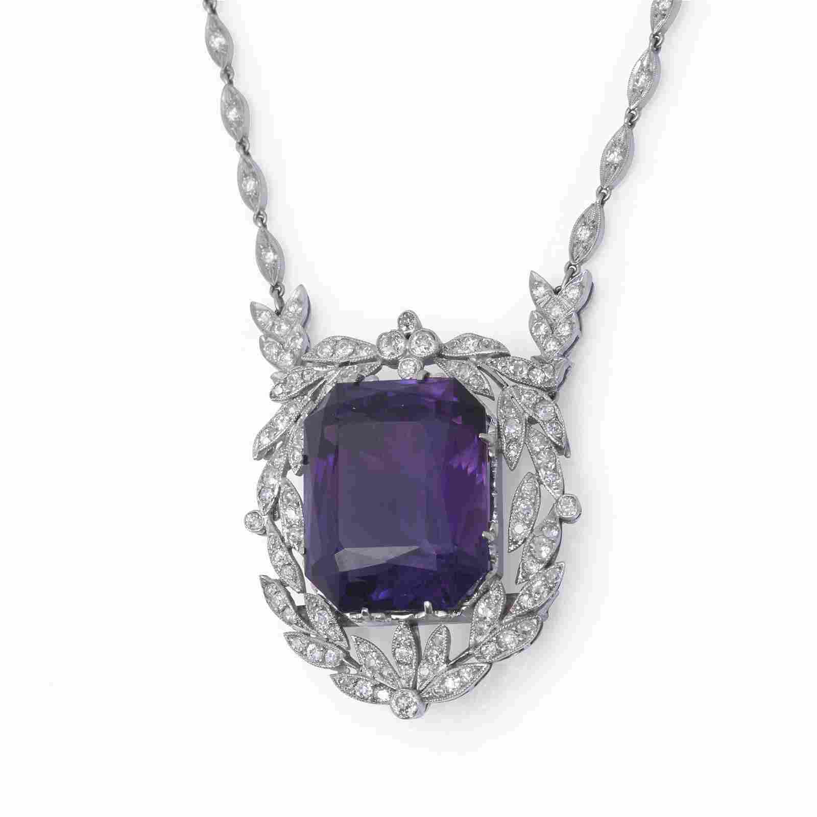 An amethyst, diamond, and platinum pendant brooch,