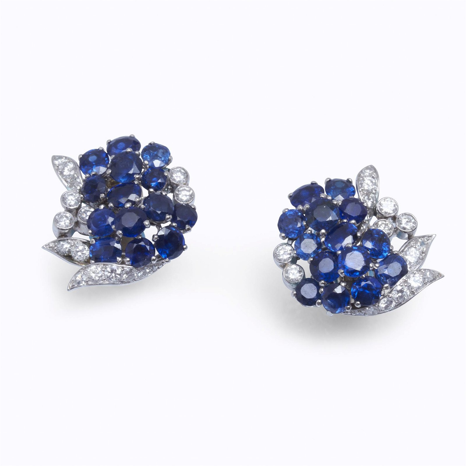 A pair of sapphire, diamond, and platinum earrings,
