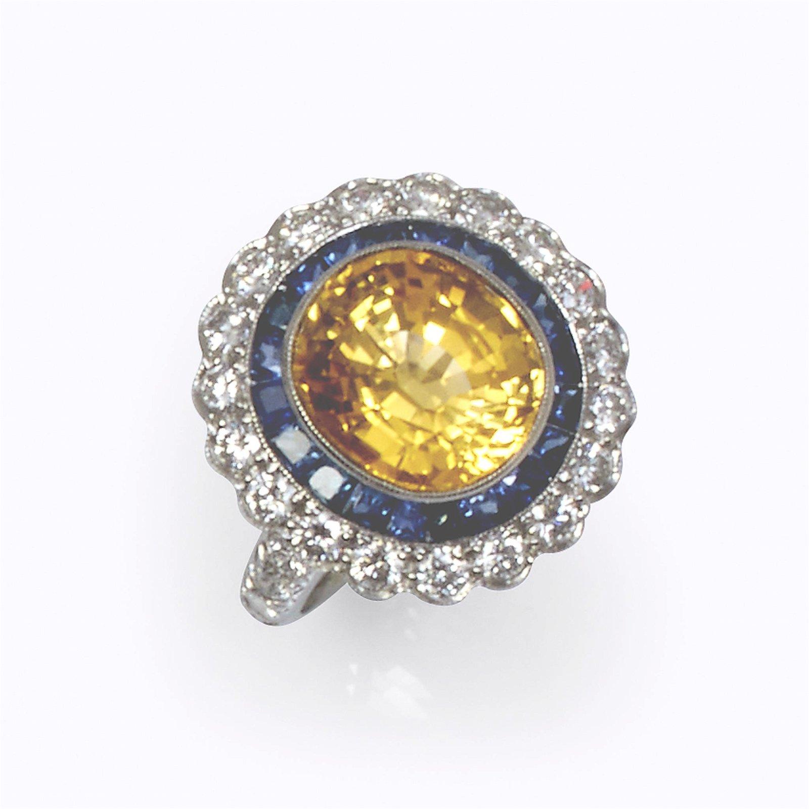 A yellow sapphire, sapphire, diamond, and platinum