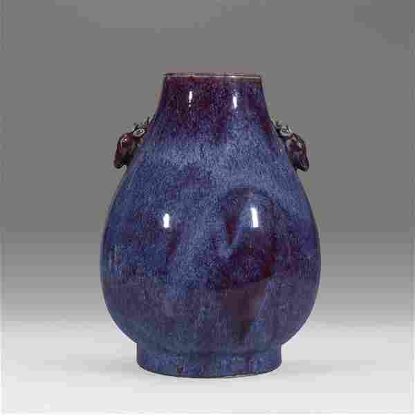 A Chinese flambe-glazed hu-form vase with deer-form