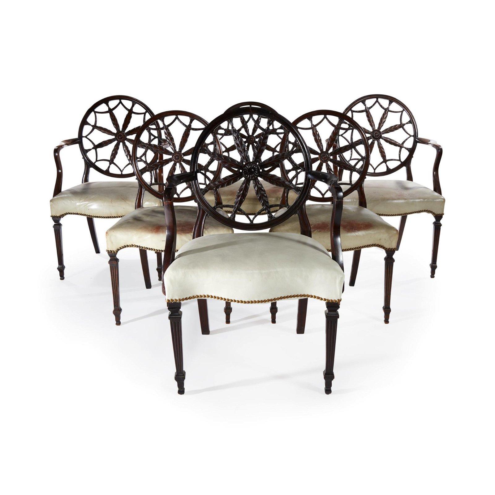 A set of twelve George III style carved mahogany wheel