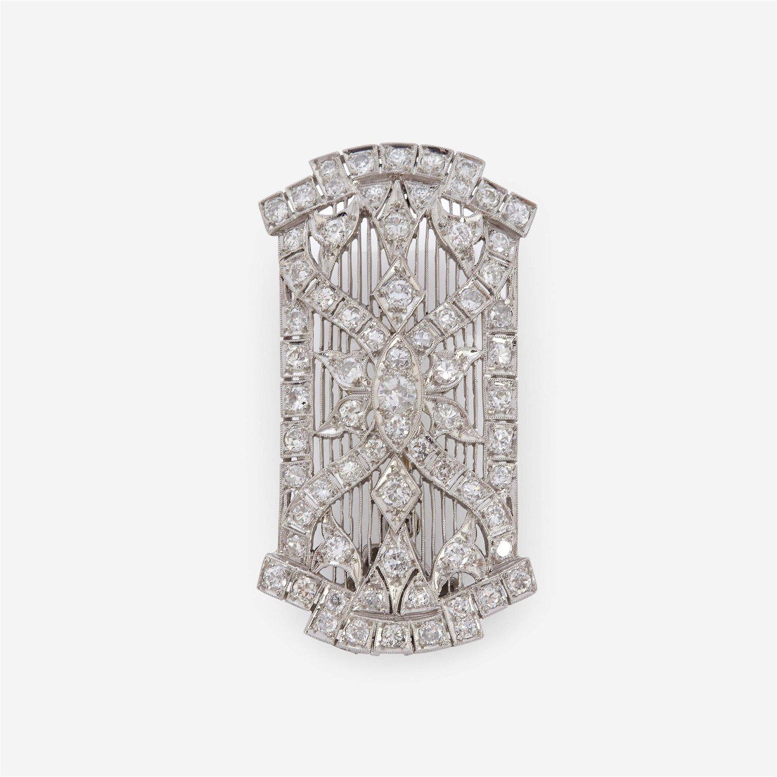 An Art Deco diamond and platinum pendant brooch,