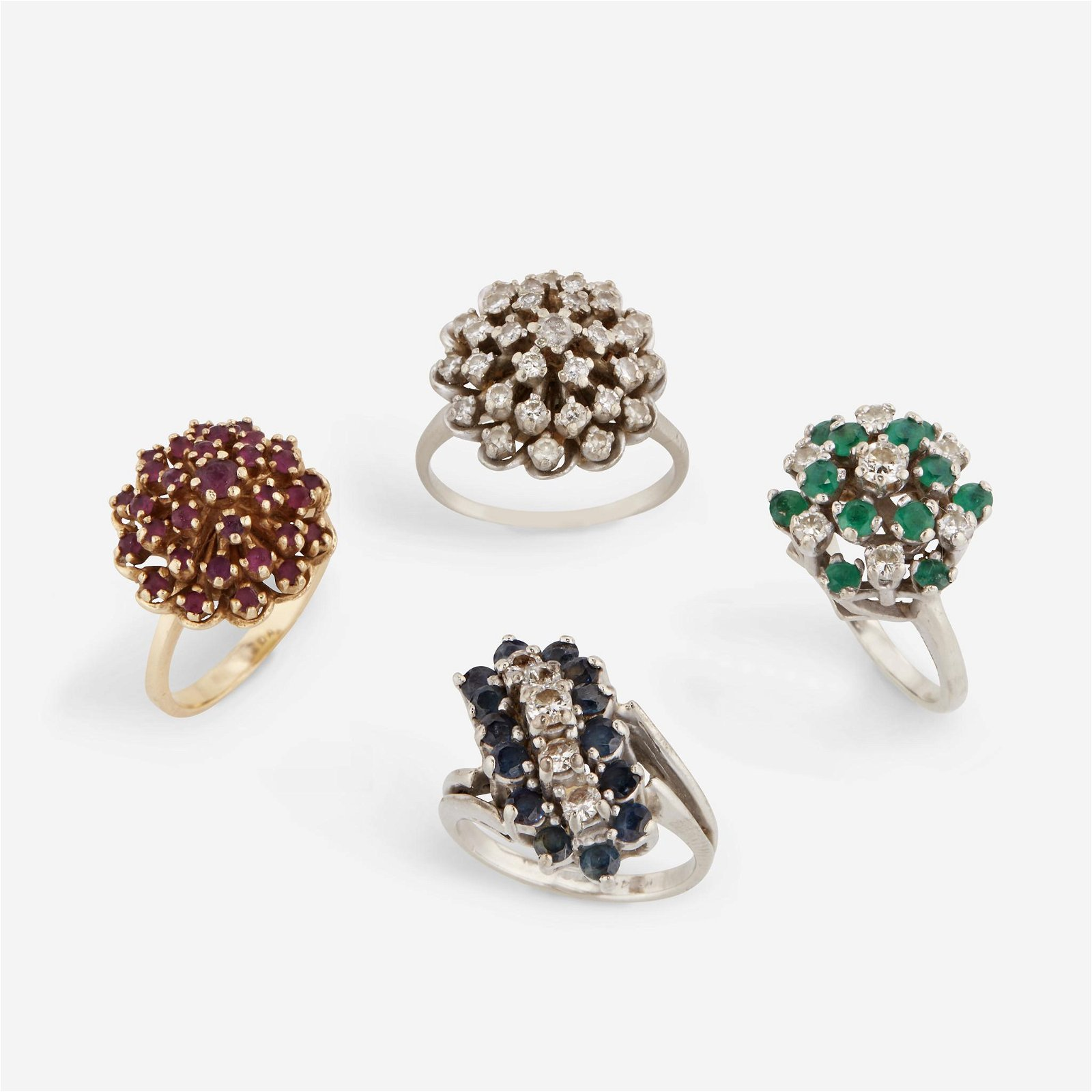 A group of four gem-set rings,
