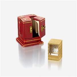 """An eighteen karat gold desk clock, Cartier, """"Prism"""