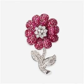 A ruby, diamond, and eighteen karat white gold brooch,