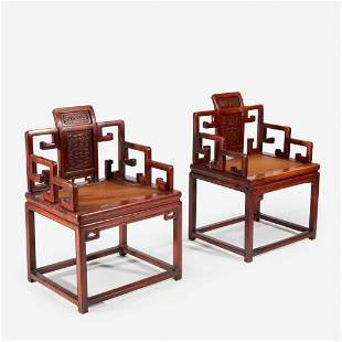 A pair of Chinese hardwood armchairs, probably Qing