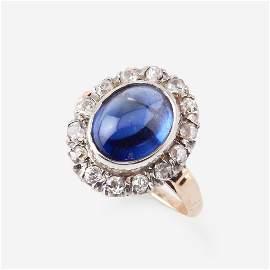 A sapphire, diamond, and fourteen karat gold ring,