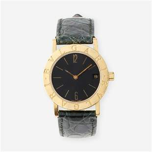 An eighteen karat gold strap wristwatch with date,