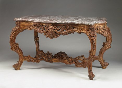 11: LOUIS XV-STYLE GILTWOOD CENTER TABLE The serpentine
