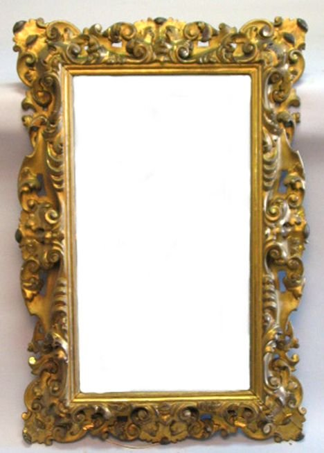 18: Italian carved giltwood mirror, 19th c., The rectan