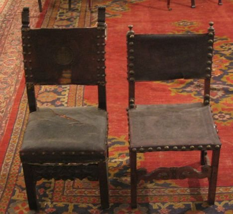 25: Two Italian walnut and leather side chairs, 17th c.