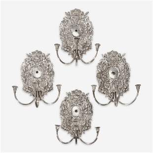 A set of four William & Mary style silverplated wall