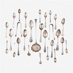 An assorted group of twenty-eight silver spoons, tongs,
