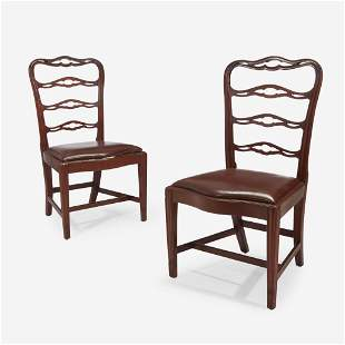 A pair of Chippendale mahogany ribbon-back side chairs