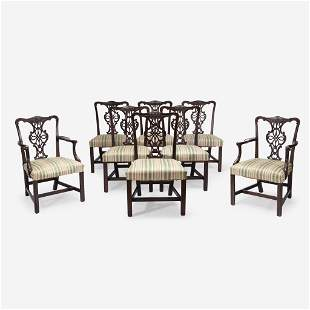 A set of eight George III style carved mahogany dining