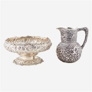 A floral repoussé sterling silver water jug and