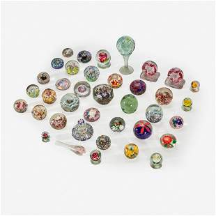 A collection of assorted glass paperweights Millville,