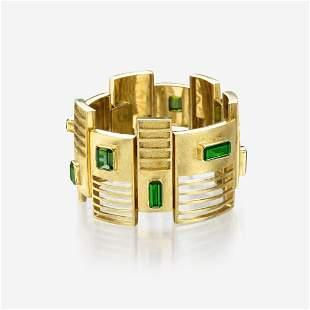 An eighteen karat gold and green tourmaline bracelet,