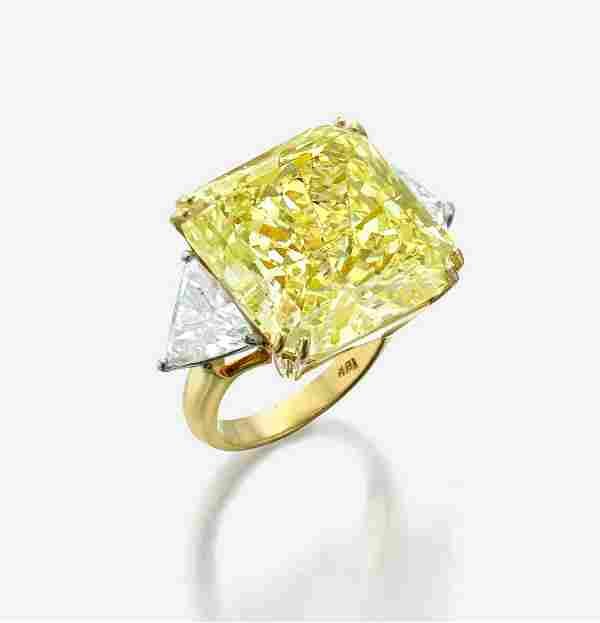 An impressive fancy light yellow diamond ring