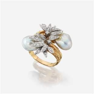 An eighteen karat gold, baroque cultured pearl, and