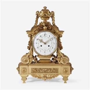 A Louis XVI Style Gilt-Bronze Mantel Clock