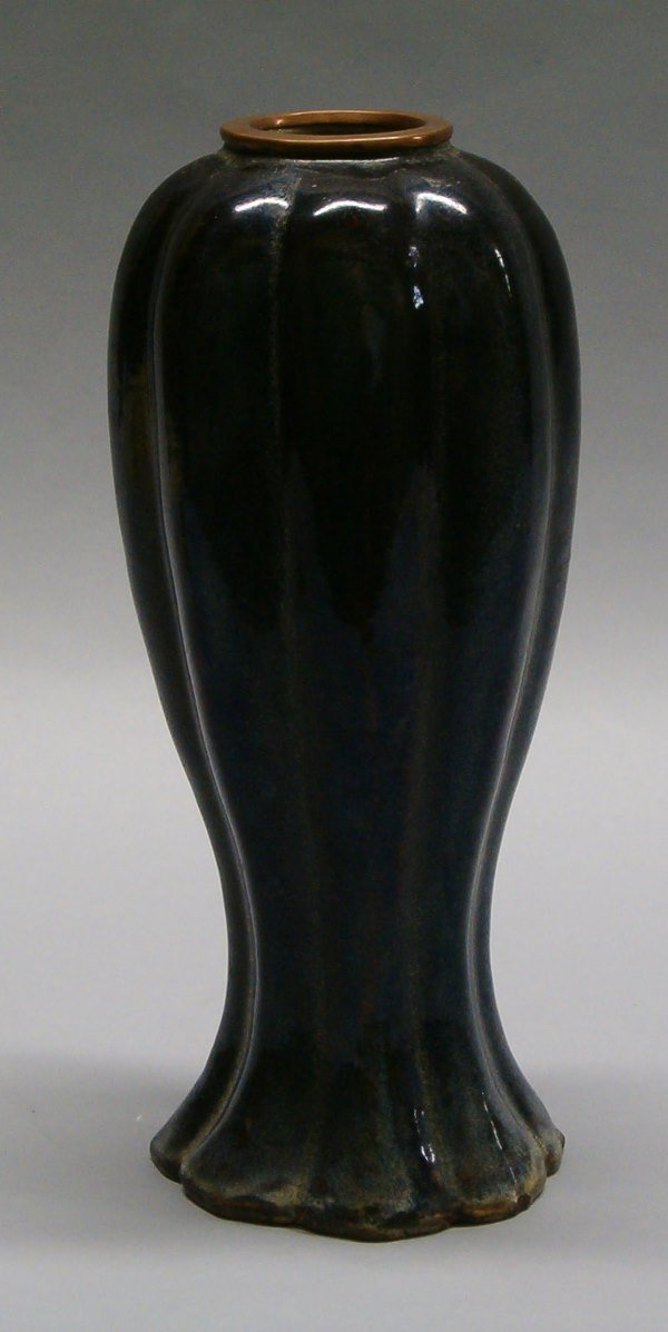 1005: CONTEMPORARY AUBERGINE POTTERY VASE LOBED FORM WI