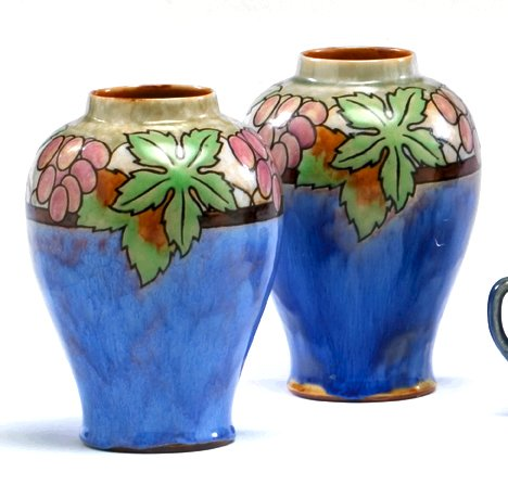 1010: Royal Doulton pair vases with grape decoration, ,